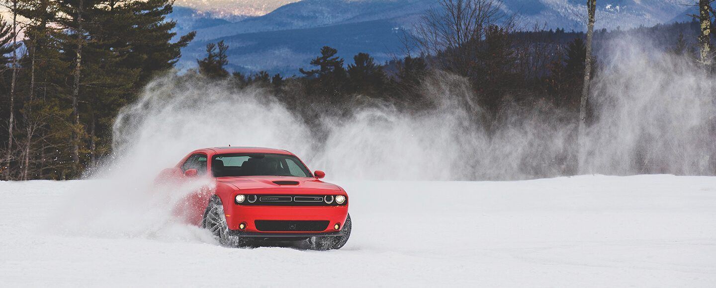 2019 red dodge challenger sxt on snow