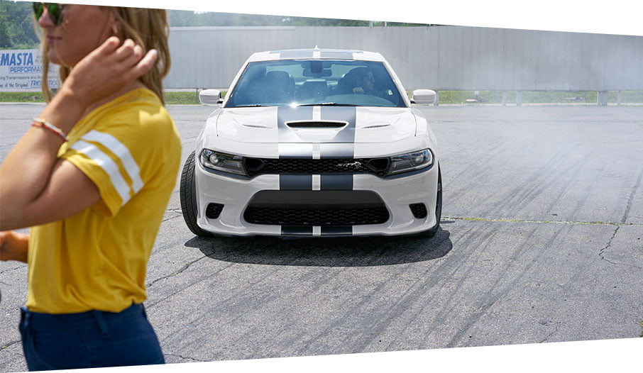 white striped dodge charger hellcat with model