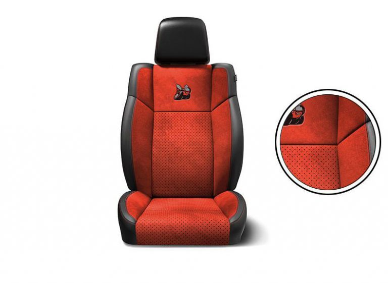 Black/ruby red Nappa leather trim with Alcantara® suede bolsters, perforated inserts and ruby red accent stitching with Bee logo.