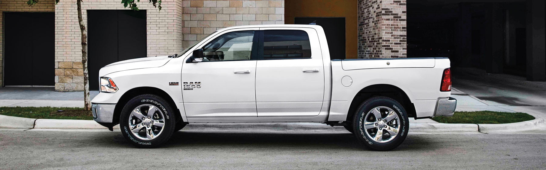 bright white ram 1500 elegance on the side of the road